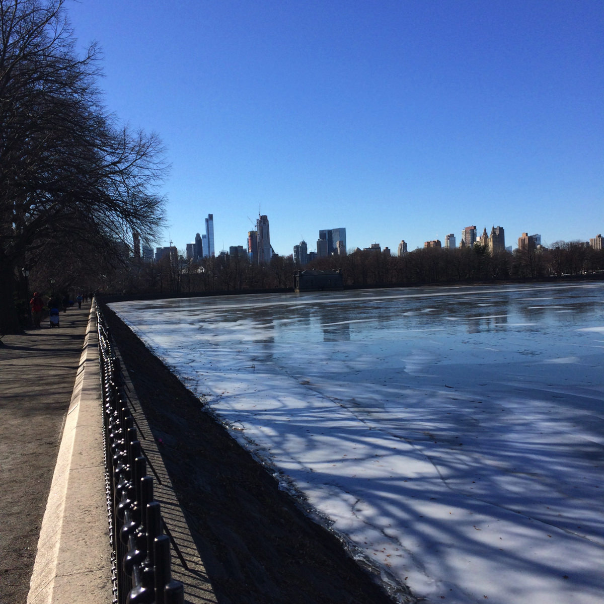 View south of the partially frozen Jacqueline Kennedy Onassis Reservoir in Central Park.